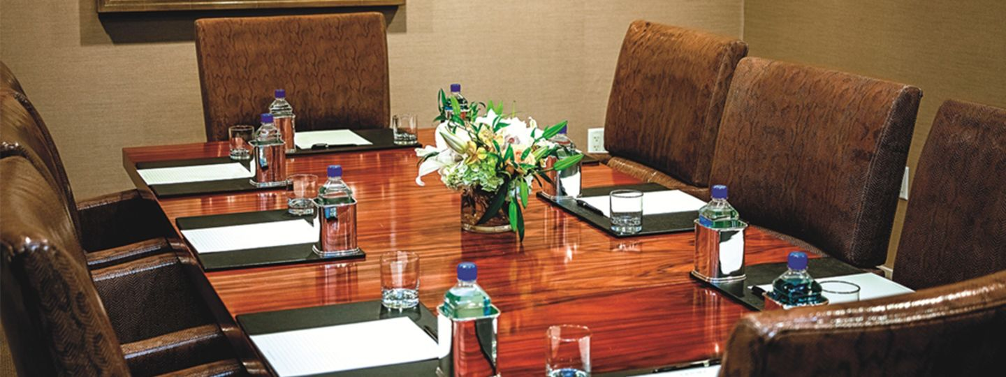 Meeting Space with Bottled Water and Flowers on the Table