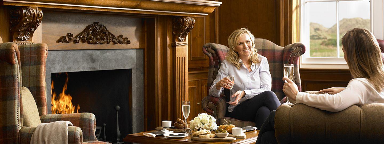 Women Sitting next to Fireplace