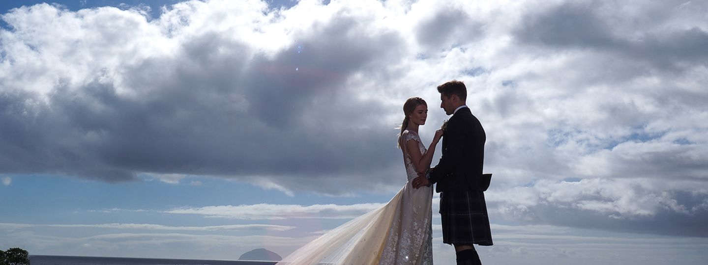 Wedding Couple with Cloudy Sky