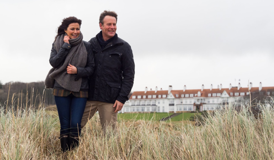 man and woman outside of Trump Turnberry during winter