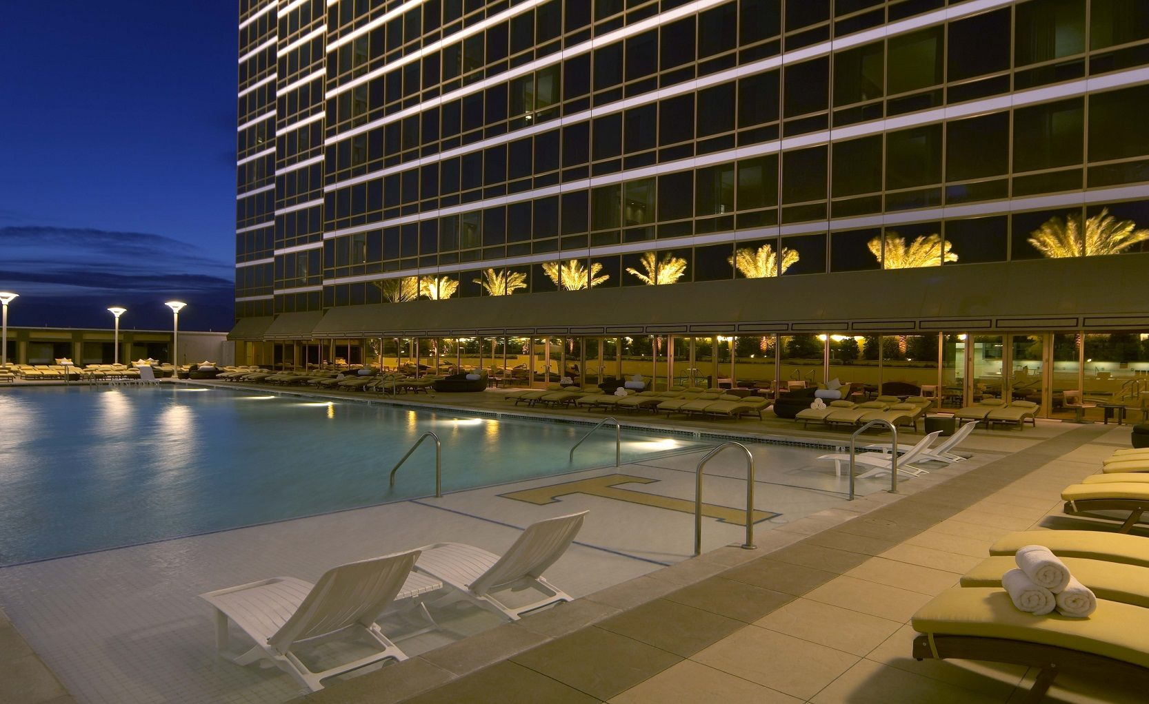 Trump Vegas poolside at night