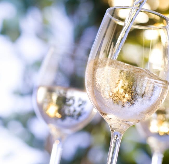 Wine Pouring into Wine Glasses