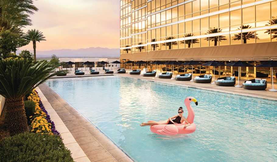 Lady on Flamingo Float in Pool