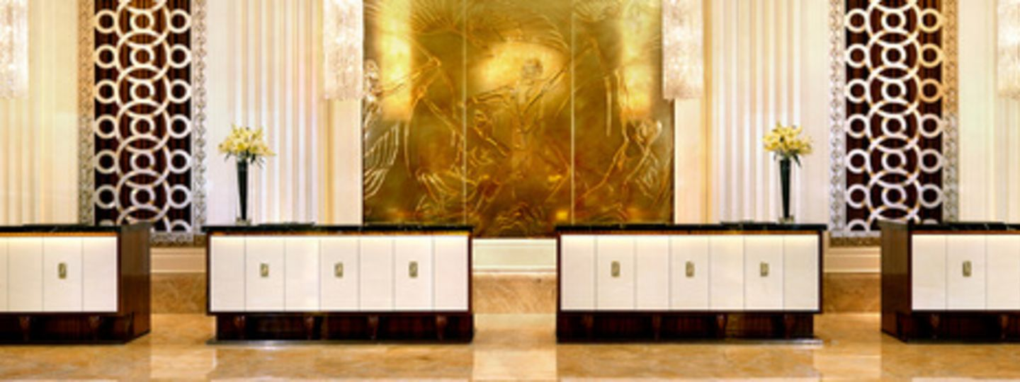 Gold, Brown, and White Hotel Lobby