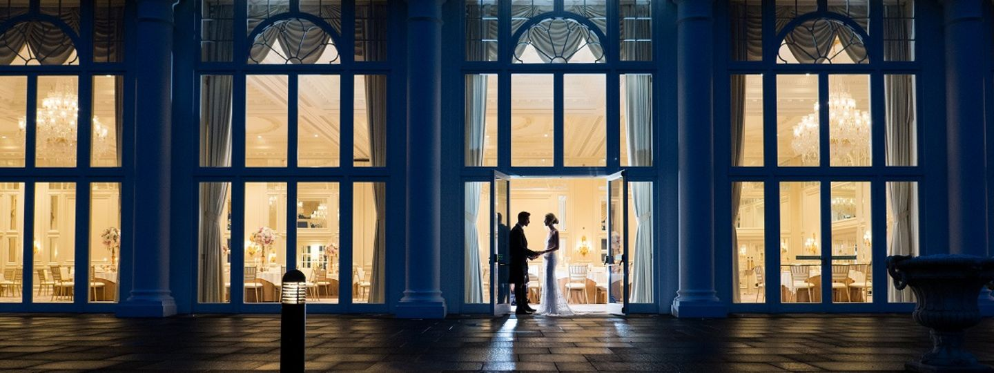 Couple Standing in Front of Ballroom