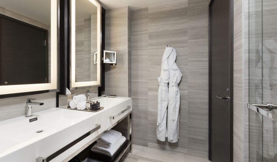 hotel interior bathroom with bathrobe on hanger