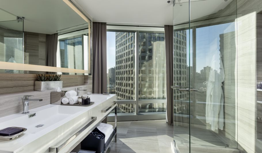 hotel interior bathroom with sinks, city view
