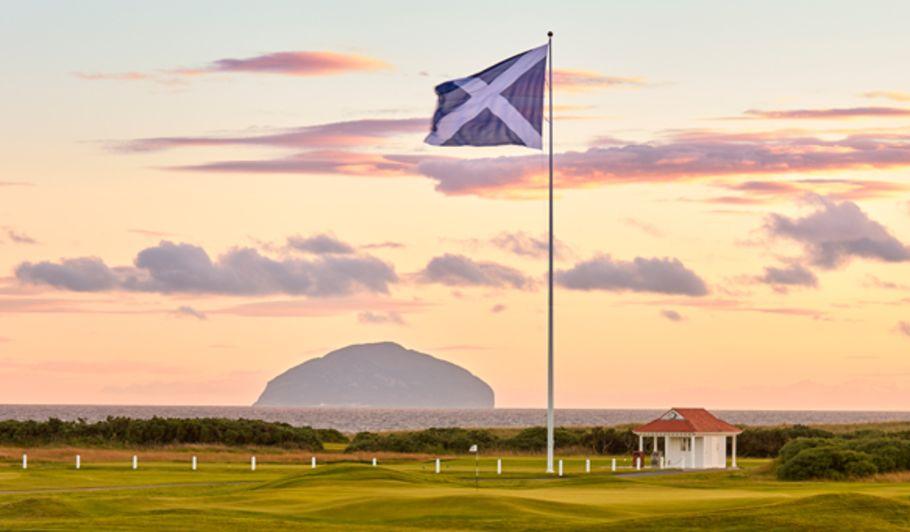 Sunset over Field & Flag