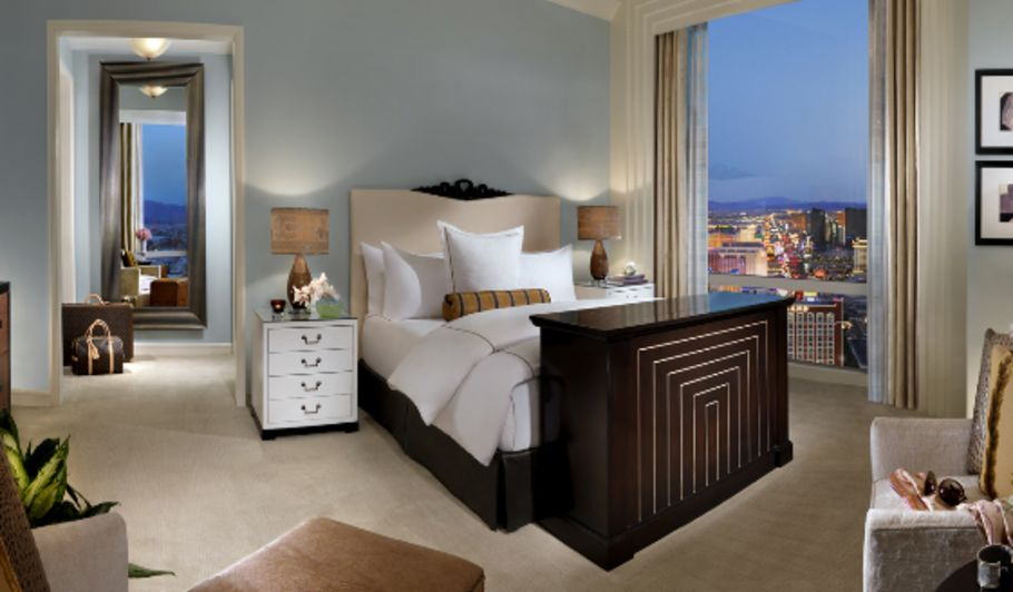 Grey Hotel Room with Bed and City View