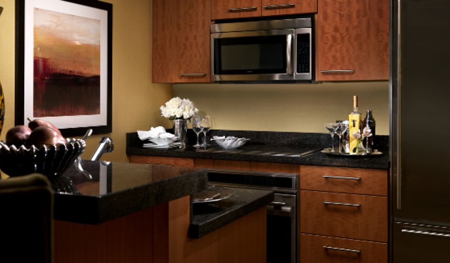 Brown and Black Hotel Suite Kitchen