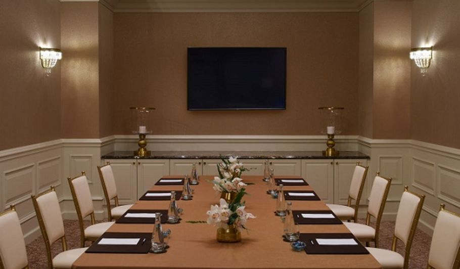 Business Meeting Room with Table and Chairs