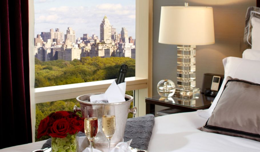 Champagne Glasses On Bed WIth NYC View