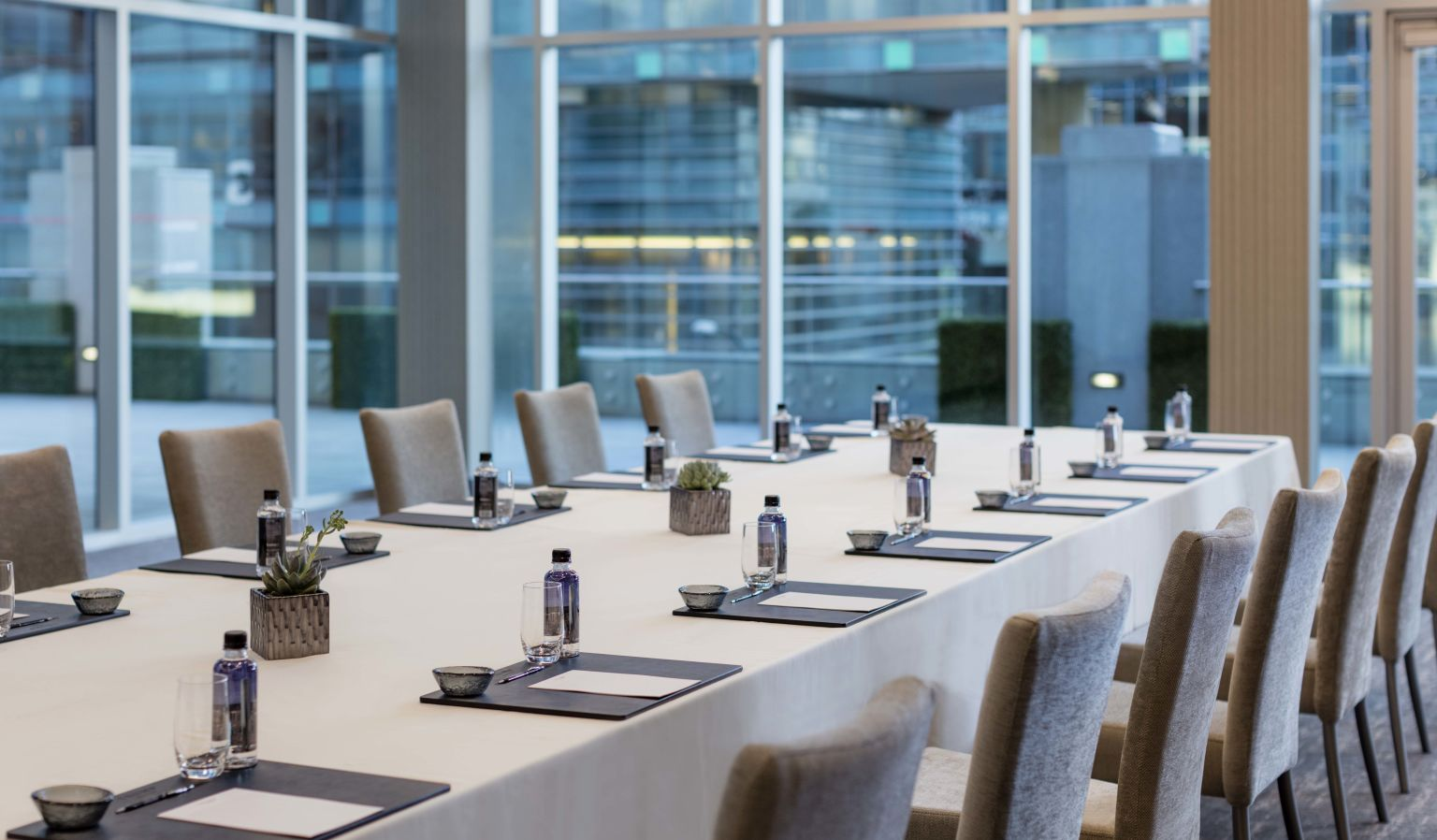 hotel interior meeting room with table arrangement, water bottles