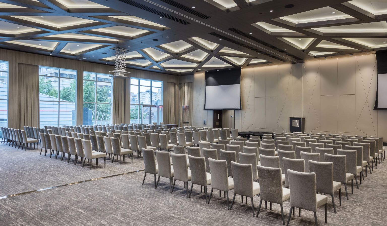 hotel interior conference room with projector, chairs