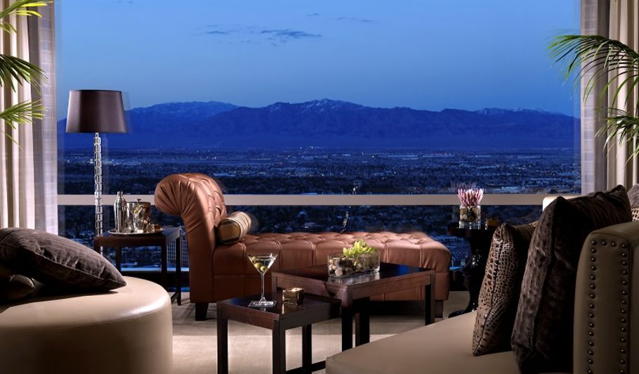 Chaise Lounge Overlooking Nighttime Mountain Landscape