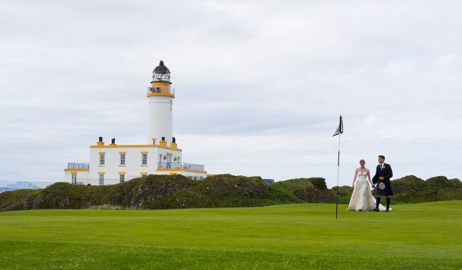 Bride and Groom on Golf Course with Lighthouse in Background