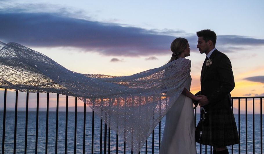 Bride and Groom on Balcony at Sunset