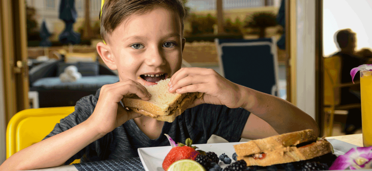 Child Holding PB and J Sandwich