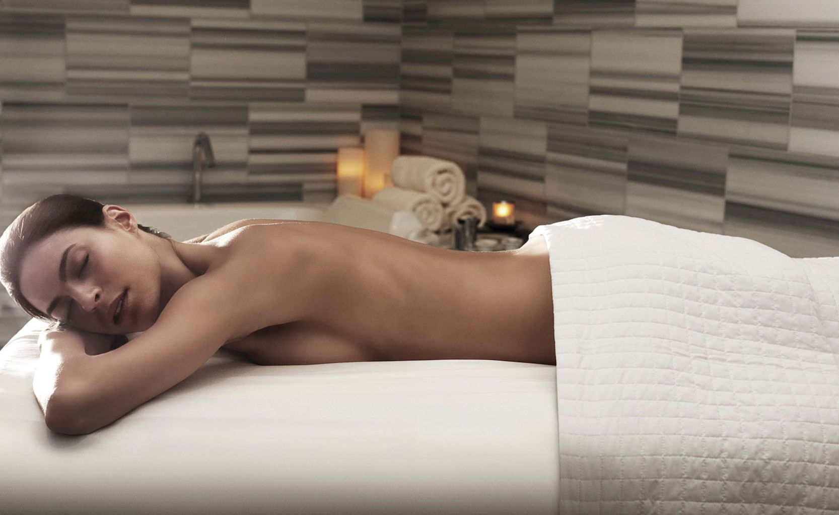 Woman Relaxing on Spa Massage Table