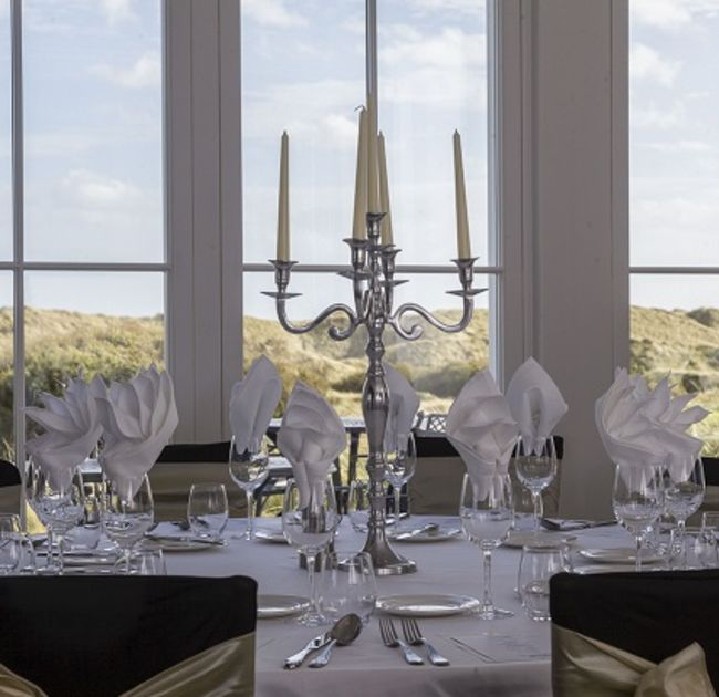 MacLeod House and Lodge event dining placement with candle