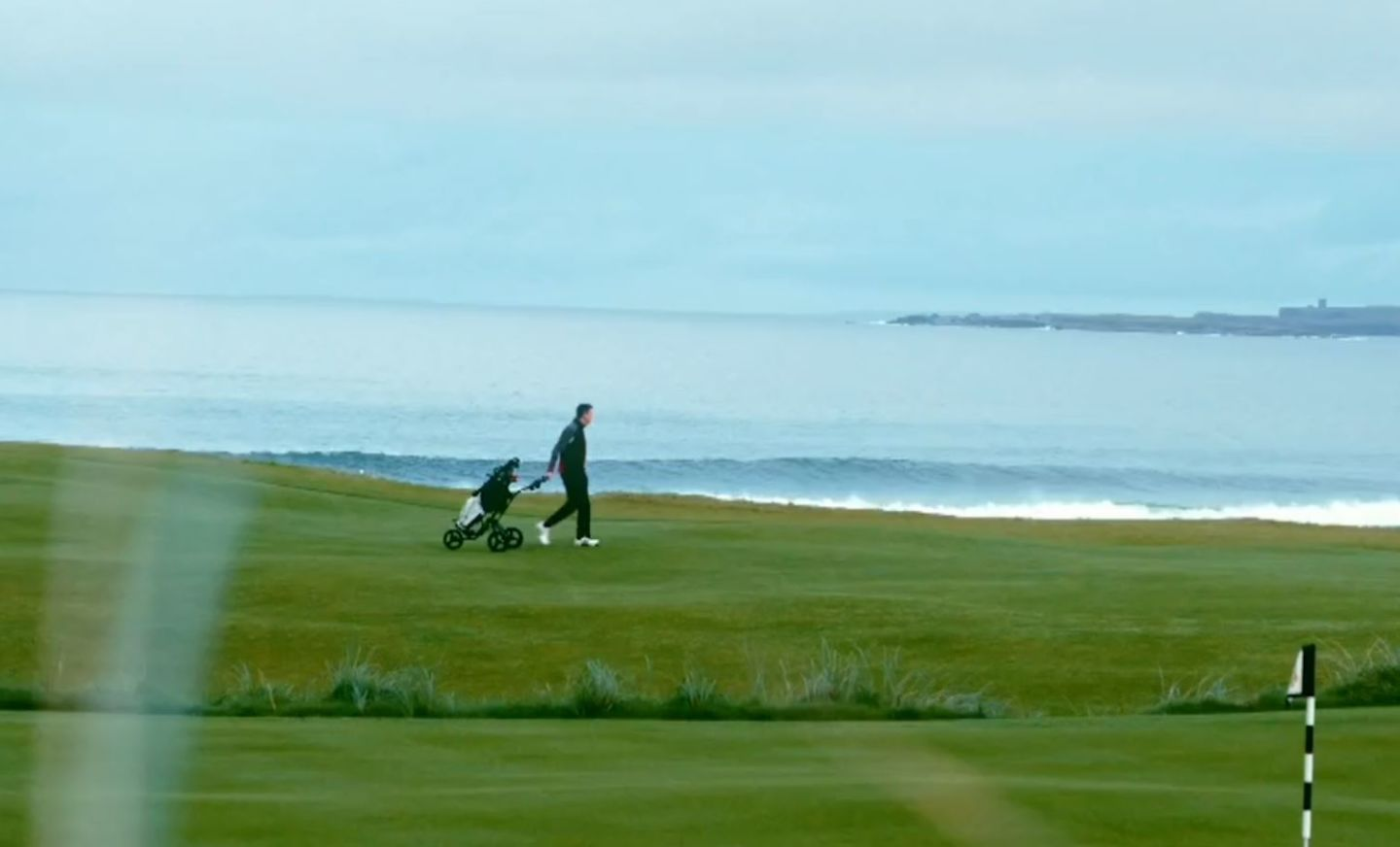Man Walking on Golf Course at Doonbeg