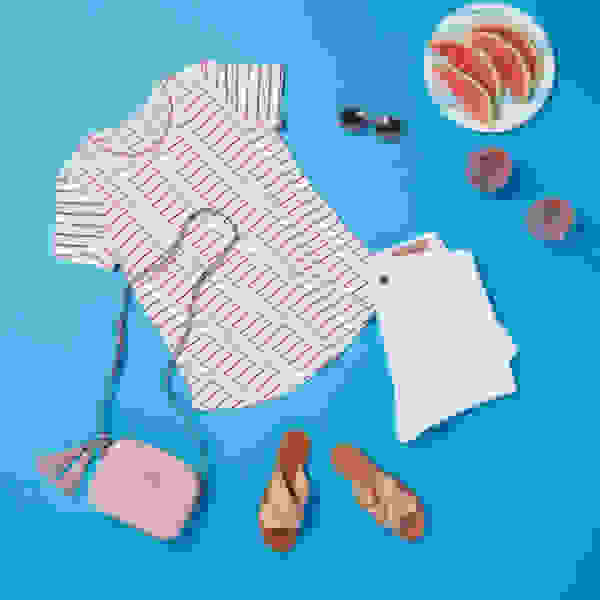 Women's striped shirt and white shorts outfit