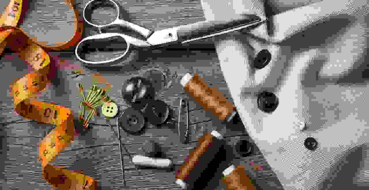 Tape measure, scissors, thread, and sewing tools