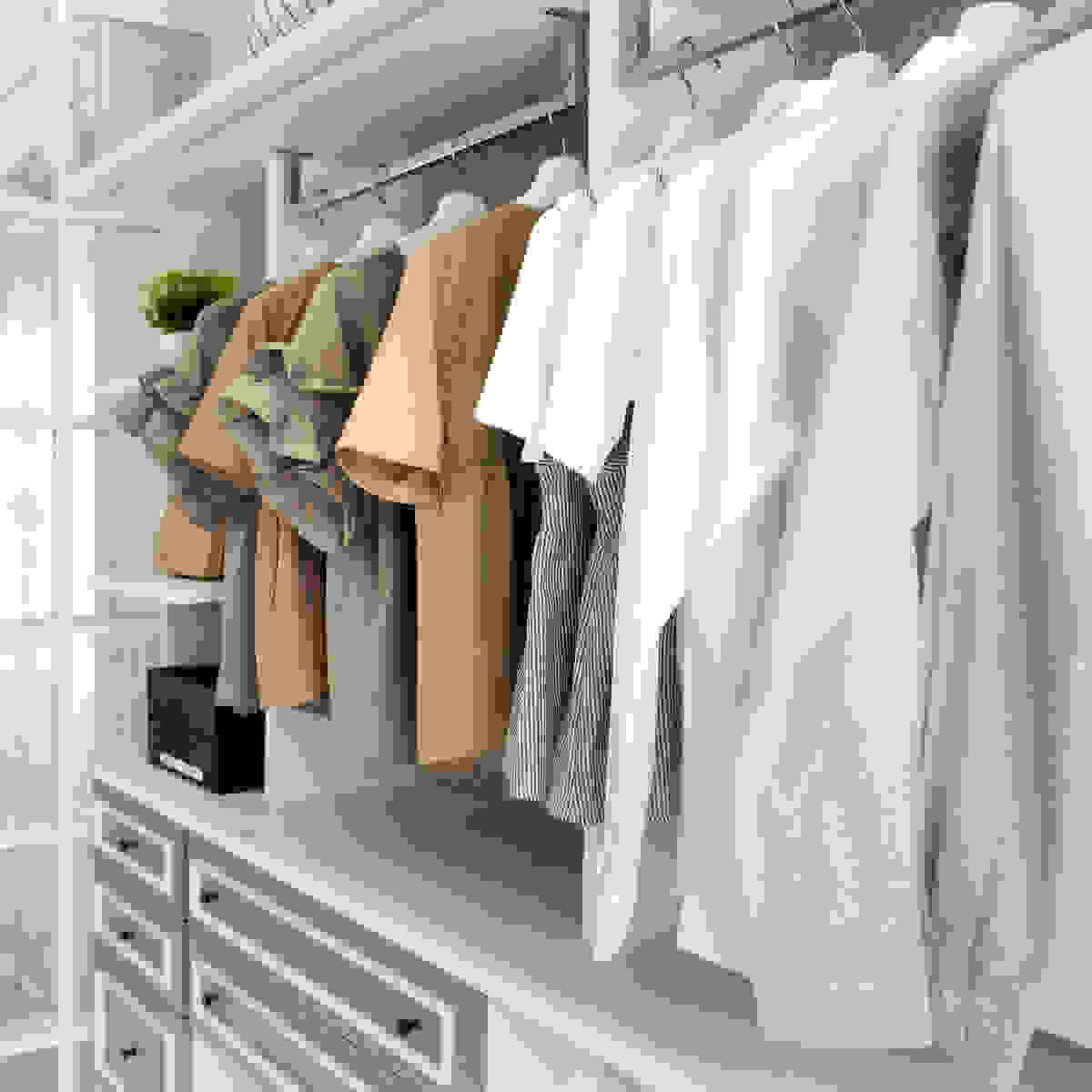 Organized closet filled with women's shirts coordinated by color.