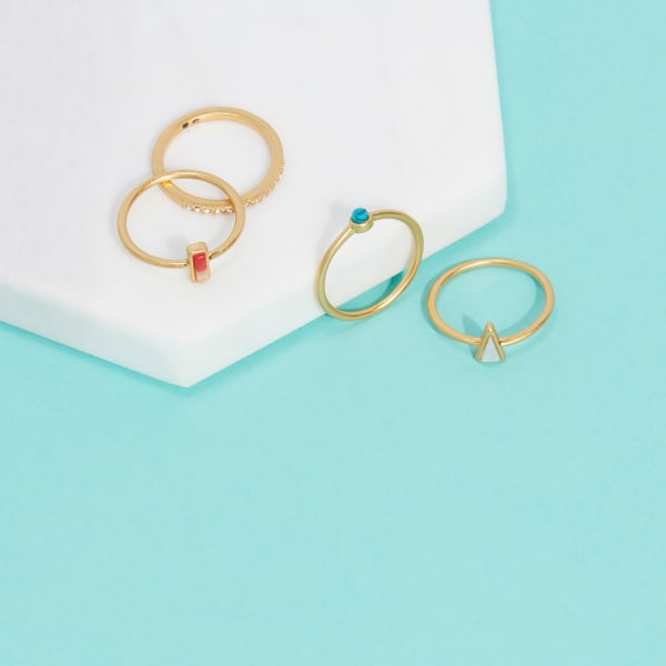 Gold rings with white, turquoise and red stones