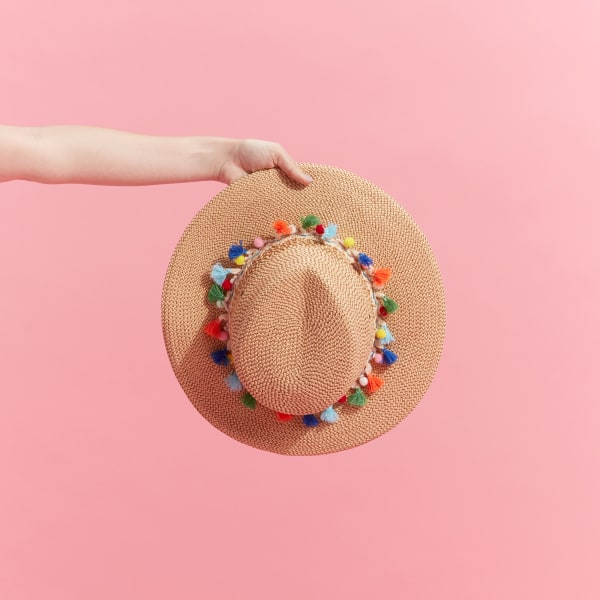 Women's crochet sun hat with pom poms