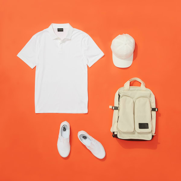 white shirt, white baseball cap, white Converse slip-on sneakers