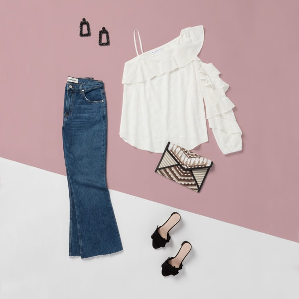 White one-shoulder blouse and jeans for girl's night out
