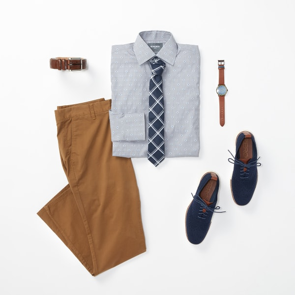Six men's fashion items - a blue patterned dress shirt, a pair of chinos, a blue tie, a pair of blue dress shoes, a watch and a tan belt - laid flat on a white background.