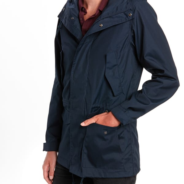 Man wearing a navy blue parka with his left hand in his pocket.