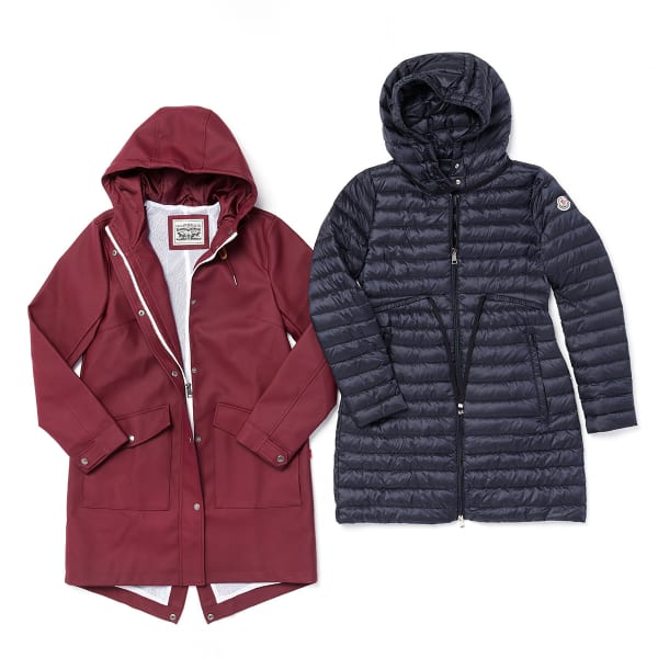 Two women's parkas - one maroon and the other a dark navy blue - laid flat on a white background.