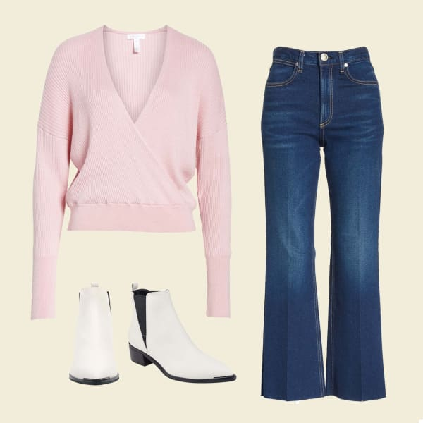 Wide-leg jeans, pink sweater, and white boots.
