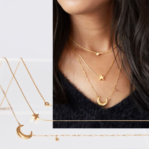 Layered necklaces with a v-neck sweater