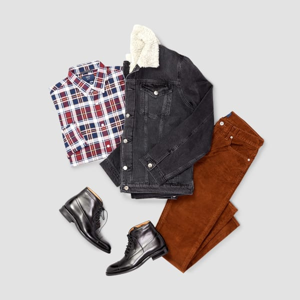 Men's outfit including brown corduroy pants, plaid shirt, denim jacket and black boots laid flat on a grey background.