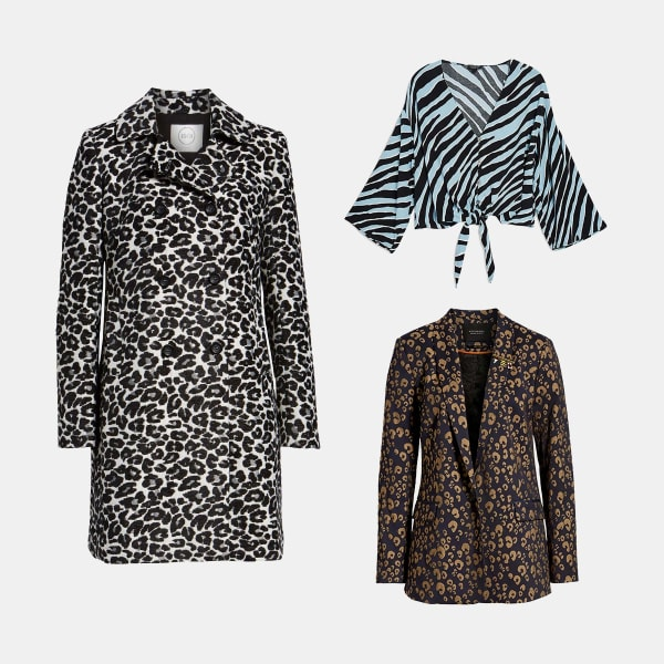 Three women's garments featuring animal print laid flat on a light grey background.