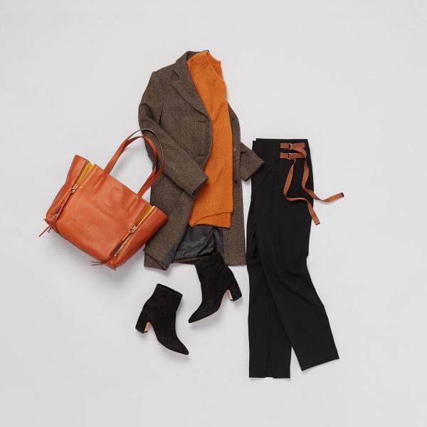 Brown jacket and black pants.