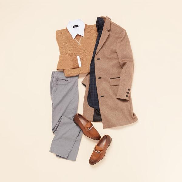 Tan coat with grey slacks.