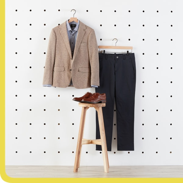 Tan blazer, black slacks, and brown shoes.