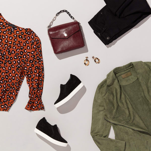 Women's leopard print top and sneakers outfit
