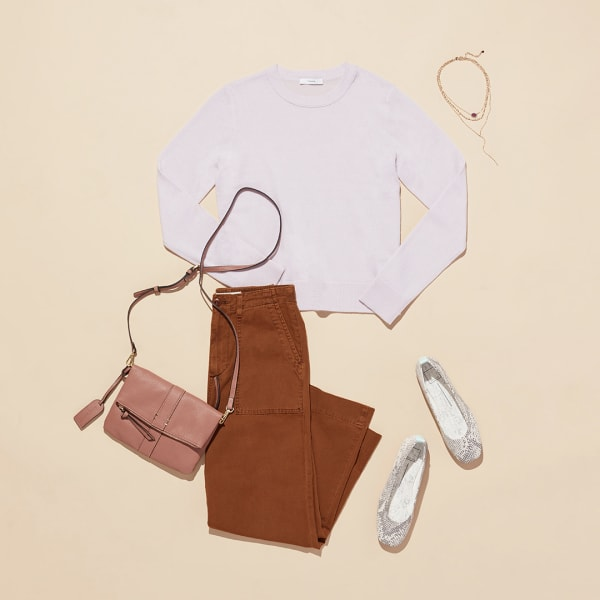 Women's sweater with pants, flats, and crossbody bag