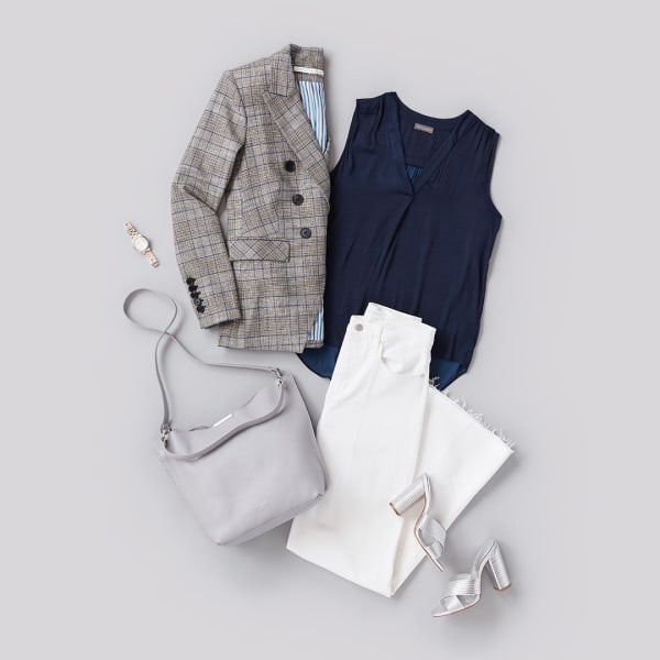 A women's blouse, blazer, white jeans, and heels.