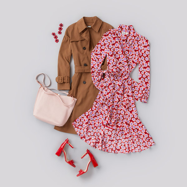 A women's floral dress, trench coat, floral earrings, and heels.