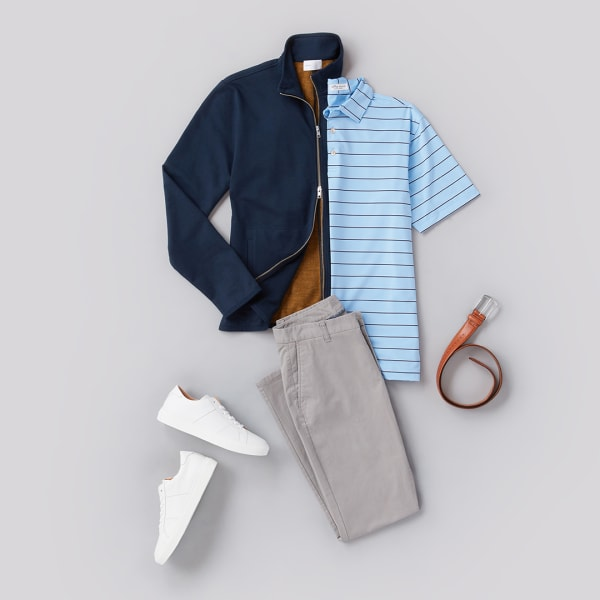 A men's polo shirt, jacket, chinos, and white sneakers.