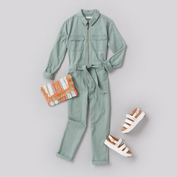 Spring jumpsuit outfit with sandals, earrings, and a clutch
