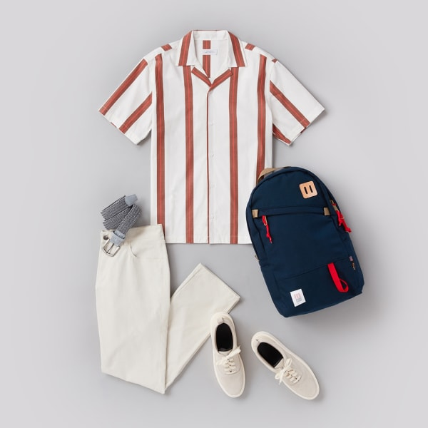 Men's striped shirt outfit with white pants and sneakers