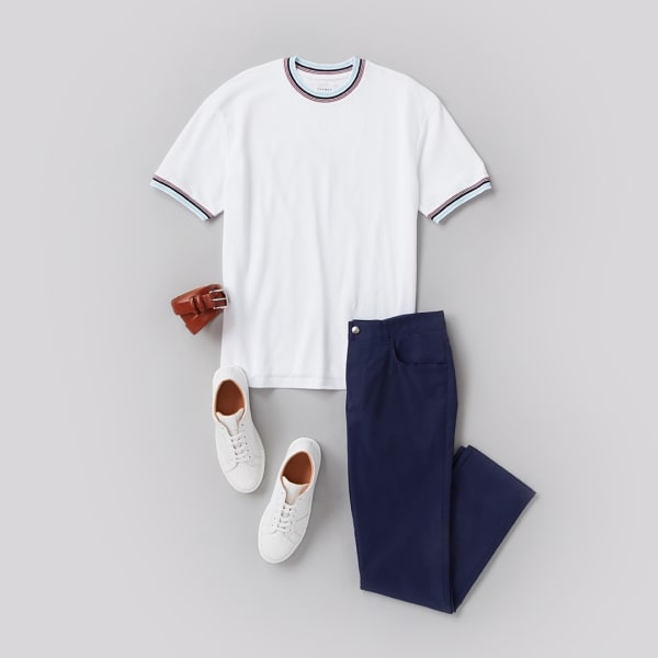 Men's white T-shirt, navy pants, and white sneakers